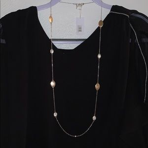 Long style necklace.